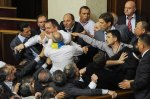 Lawmakers fight in Ukrainian parliament.